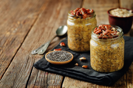 Pumpkin Chia seeds overnight oats with pecans. toning. selective focus