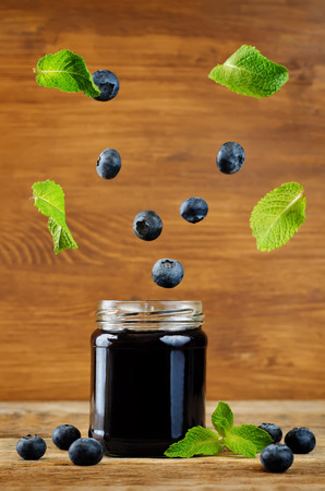 blueberry jam with flying mint and fresh blueberries. toning. selective Focus