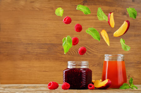 raspberry and peach jams with flying slices. toning. selective Focus