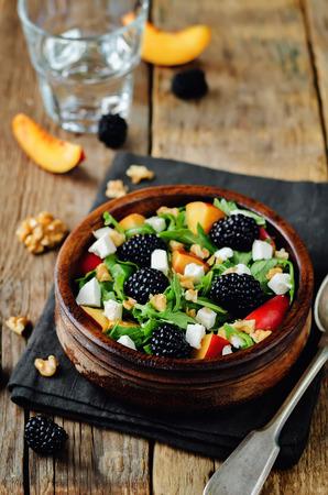 Arugula peach berry goat cheese salad. toning. selective focus Stock Photo