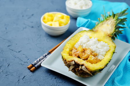 Pineapple stuffed rice with pineapple cashews chicken. toning. selective focus Stock Photo