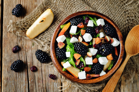 Pear arugula blackberry almond goat cheese dried cranberry salad. toning. selective focus Stock Photo
