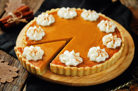 Pumpkin pie on a wood background. toning. selective focus Stock Photo