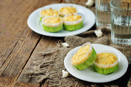Cheesy cauliflower muffins on a wood background. toning. selective focus Stock Photo