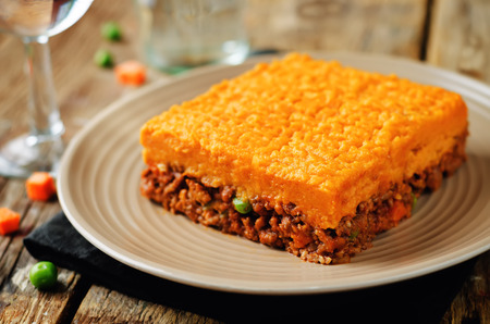 Sweet potato Shepherds pie on a wood background. toning. selective focus