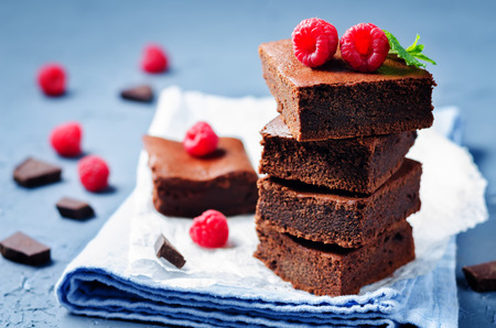 Chocolate cake Brownie with raspberries. toning. selective focus
