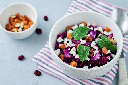Red Cabbage with Cranberries, Almonds and Goat Cheese stew. toning. selective focus