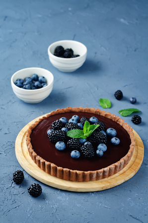 Chocolate tart with blackberries and blueberries. toning. selective focus