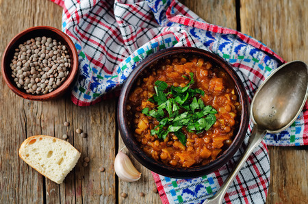 Cabbage Lentil stew on a wood background. toning. selective focus Imagens