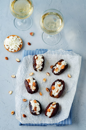 Almond and goat cheese stuffed dates. toning. selective focus 版權商用圖片