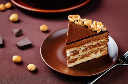 Merengue hazelnut chocolate cake. toning. selective focus Stock Photo - 87902384
