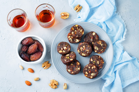 Dates and nuts roll. Indian sweets. Khajoor Katri. toning. selective focus Stock Photo