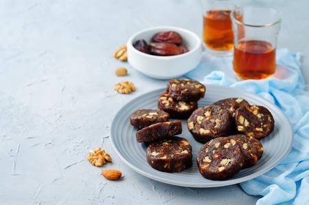 Dates and nuts roll. Indian sweets. Khajoor Katri. toning. selective focus Фото со стока