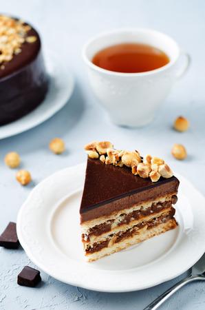 Merengue hazelnut chocolate cake. toning. selective focus Stock Photo - 88145909