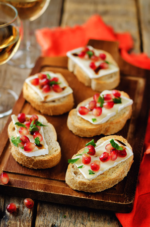 Pomegranate Brie balsamic crostini. toning. selective focus