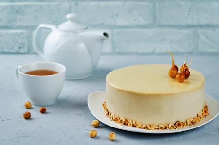 Caramelized white chocolate dried apricots hazelnut mousse cake. toning. selective focus