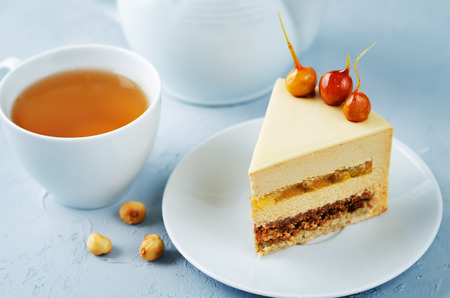 Caramelized white chocolate dried apricots hazelnut mousse cake. toning. selective focus