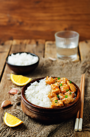 Orange glaze chicken with rice. toning. selective focus Stock Photo