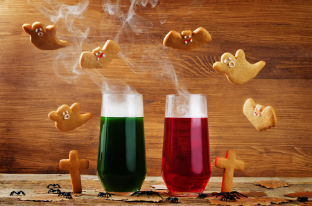Halloween drinks with flying cookies on a wood background. toning. selective focus Stock Photo