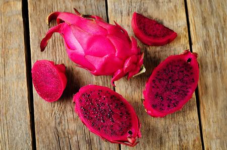 Pitaya, dragon fruit on a wood background. toning. selective focus