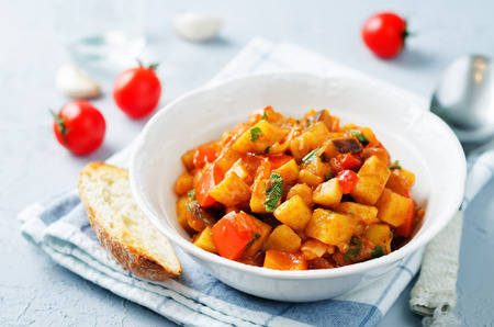 Eggplant potato Bell pepper goulash on a stone background. toning. selective focus