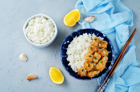 Orange teriyaki chicken with rice. toning. selective focus