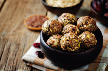 White chocolate pistachio dates oats flax seed raw balls. toning. selective focus