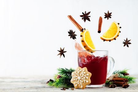 Mulled wine with flying ingredients to prepare it on a white background. toning. selective focus Stock Photo