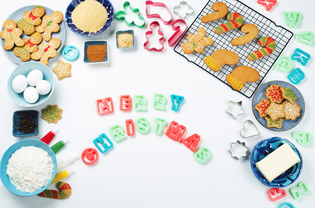 Merry Christmas words with ingredients for baking on a white background. toning. selective focus