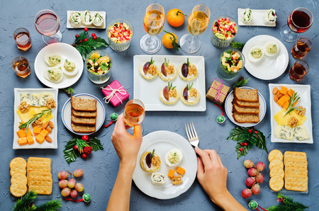 Christmas appetizers celebration table setting with womans hands. toning. selective focus Stock Photo
