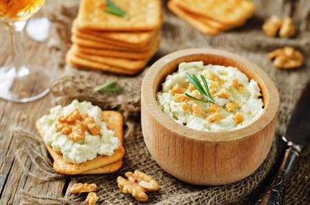 Blue cheese spread with walnuts on wood background. toning. selective focus Stok Fotoğraf