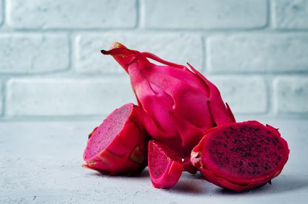 Pitaya, dragon fruit on a stone background. toning. selective focus