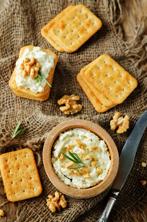 Blue cheese spread with walnuts on wood background. toning. selective focus Stock Photo
