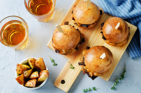 French Onion beef sliders with beer on a stone background. toning. selective focus Stock Photo