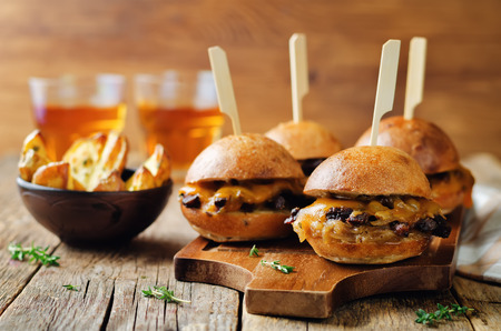 French Onion beef sliders with beer on a wood background. toning. selective focus Stok Fotoğraf - 93463806
