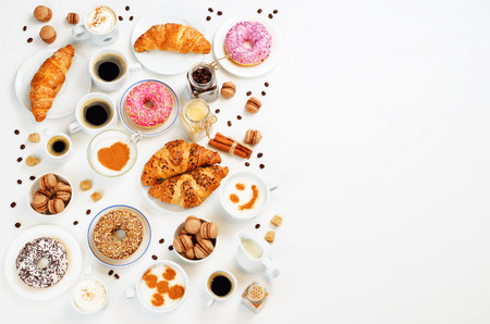 White background with different types of coffee and desserts to them. toning. selective focus