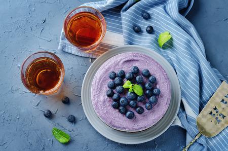 Raw vegan Blueberry Cashews cake on a stone background. toning. selective focus 版權商用圖片