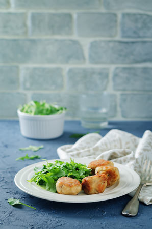 Turkey meatballs with arugula on a stone background. toning. selective focus