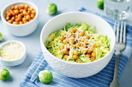 Shreded Brussels sprouts roasted chickpeas Parmesan salad. toning. selective focus