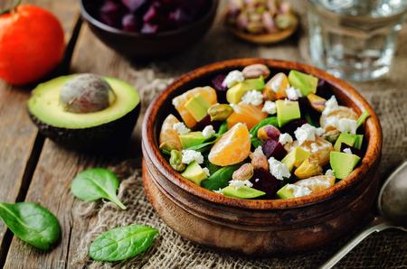 Spinach mandarin beet Feta pistachios salad. toning. selective focus Archivio Fotografico - 95245055