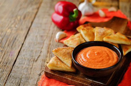 Roasted Red Bell Pepper Feta cheese dip with roasted pita. toning. selective focus