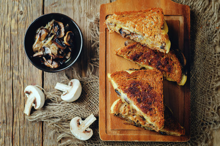 Gauda Cheese roasted Mushrooms and onion rye sandwich. toning. selective focus Stockfoto