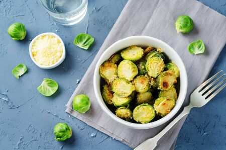 Parmesan Roasted Brussel Sprouts on a stone background. toning. seletive focus