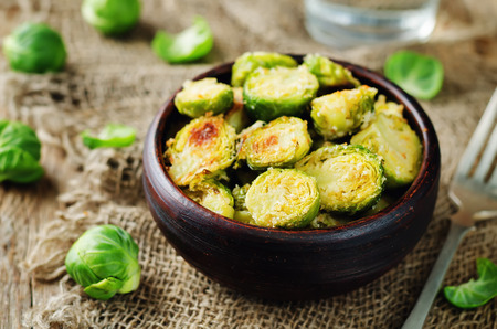 Parmesan Roasted Brussel Sprouts on a wood background. toning. seletive focus 写真素材