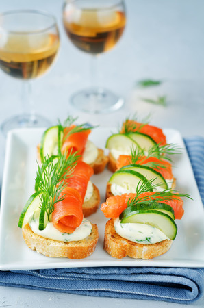 Smoked Salmon Cucumber cream cheese Spread appetizers. toning. selective focus