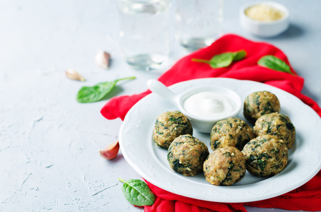 Cheese spinach balls with greek yogurt sauce. toning. selective focus Stock Photo