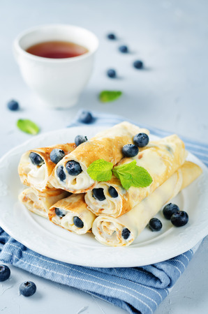 Sauteed Cream cheese Blueberry Crepes on a stone background. toning. selective focus