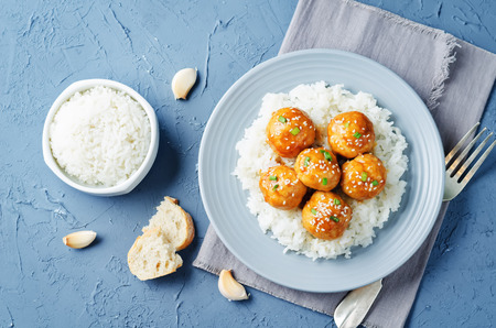 Baked Orange Chicken Meatballs with rice. toning. selective focus
