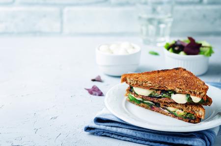 Fresh green mozzarella grilled rye sandwich on a stone background. toning. selective focus Stockfoto