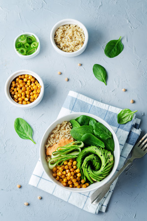 Roasted Chickpeas Spinach Quinoa Avocado Cucumber Buddha bowl. toning. selective focus